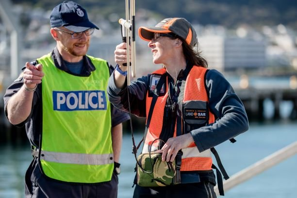 Police working with a LandSAR volunteer in Wellington using wander search equipment to locate a missing person who is wearing a Wander Search device.